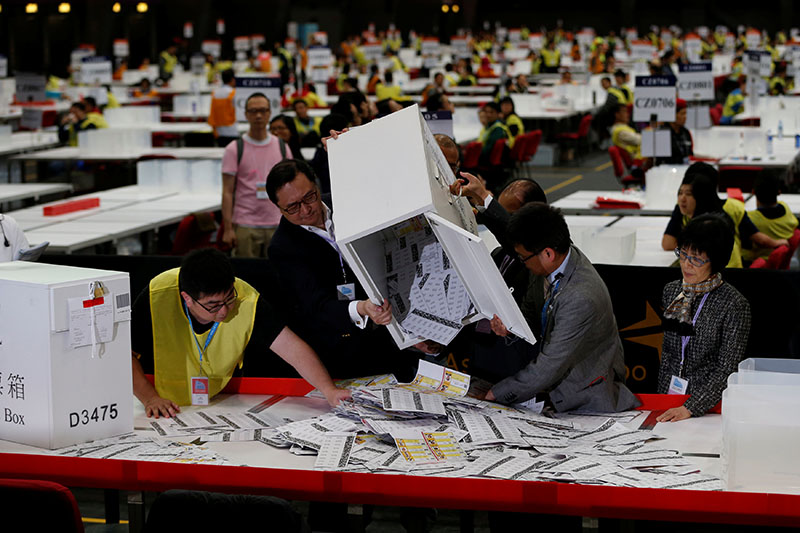 Electoral officers empty a ballot box at a vote counting center following the Legislative Council election in Hong Kong, China, on  September 5, 2016. Photo: Reuters