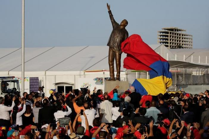 A statue of Venezuela's late President Hugo Chavez is unveiled during an event at the entrance of the Venetur Hotel Convention Center, venue of the 17th Non-Aligned Summit in Porlamar, Venezuela September 16, 2016. REUTERS/Marco Bello