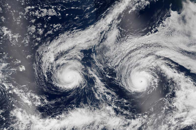 This satellite image taken on Monday, August 29, 2016 and released by NASA shows Hurricane Madeline (left) and Hurricane Lester over the Pacific Ocean in a composite built from two overpasses by the Visible Infrared Imaging Radiometer Suite on the Suomi NPP satellite. Photo: NASA via AP