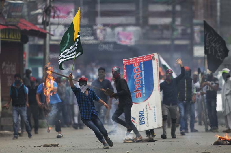 File-A Kashmiri protester holds a flag of Pakistan occupied Kashmir during a protest in Srinagar, Indian controlled Kashmir, on September 1, 2016. Photo: AP