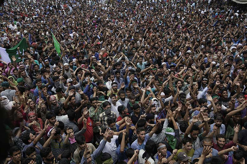 File- Kashmiris shout pro freedom slogans during a joint funeral of four civilains at Aripanthan village, west of Srinagar, Indian controlled Kashmir, on Tuesday, August 16, 2016. Photo: AP