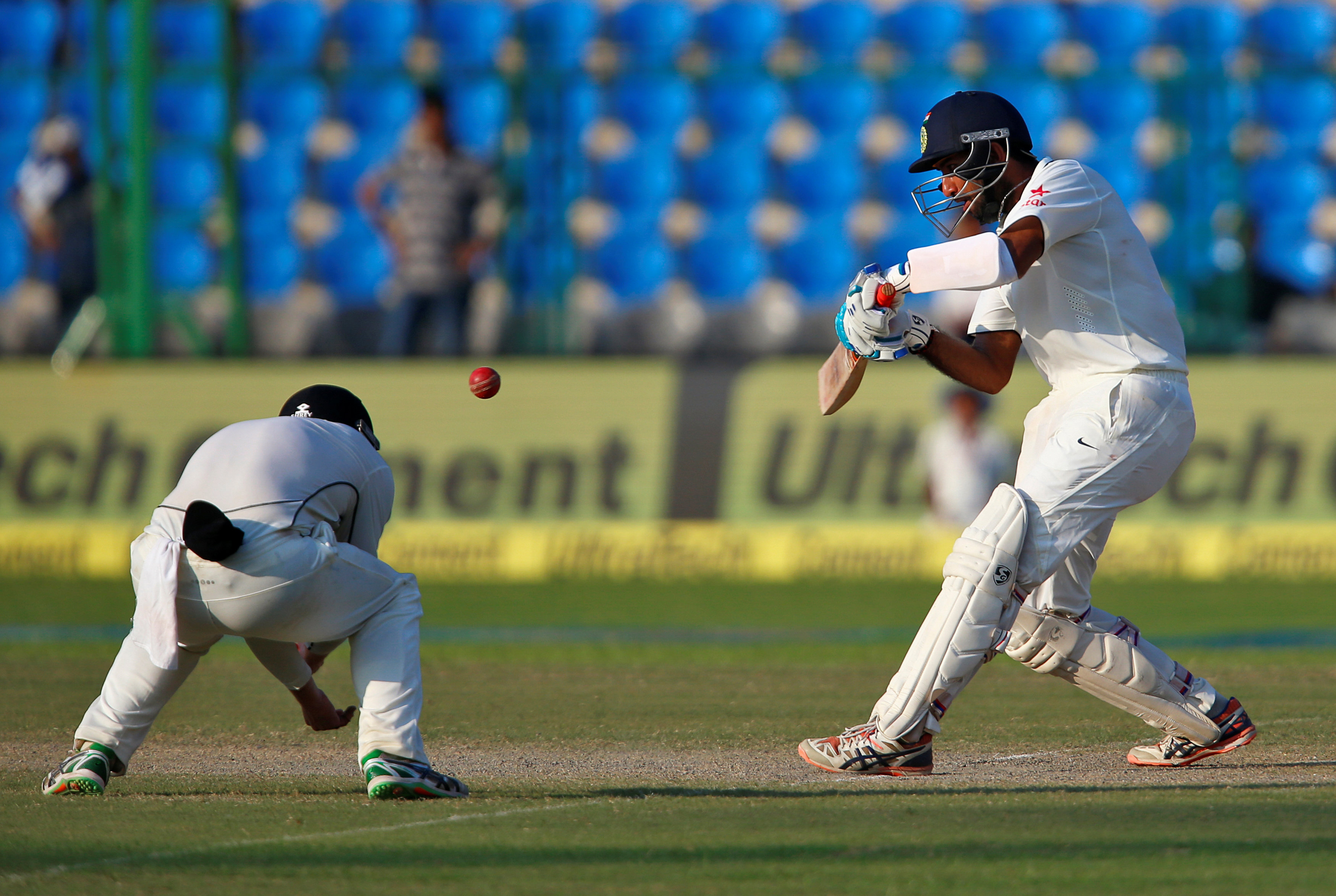 India's Cheteshwar Pujara plays a shot in the first test cricket match against at Green Park Stadium in Kanpur, India, on Saturday, September 24, 2016. Photo: Reuters