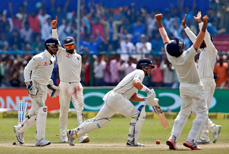 India's cricket players celebrate after winning the match. Photo: Reuters