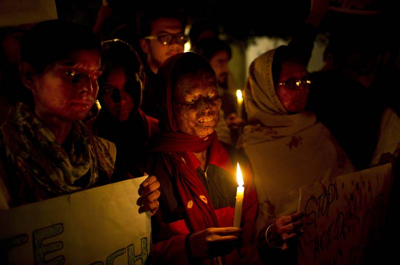 File- Acid attack survivors participate in a candlelit vigil protesting violence against women as they mark the second anniversary of the deadly gang rape of a student on a bus, in New Delhi, India, on December 16, 2014. Photo: AP