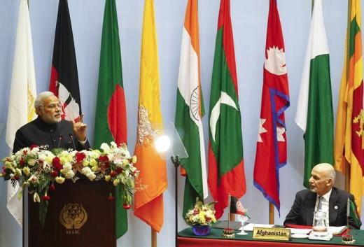 India's Prime Minister Narendra Modi (L) speaks as Afghanistan's President Ashraf Ghani watches during the opening session of 18th South Asian Association for Regional Cooperation (SAARC) summit in Kathmandu November 26, 2014. REUTERS/Narendra Shrestha/Pool