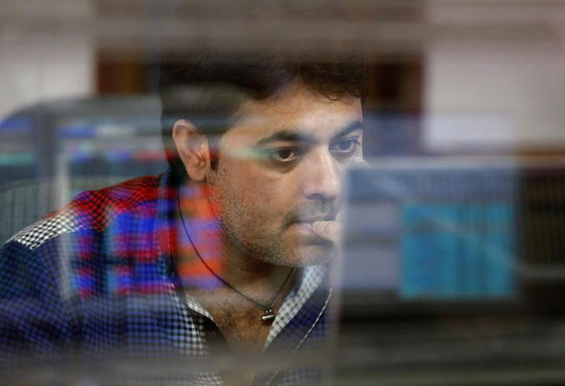 A broker reacts while trading at his computer terminal at a stock brokerage firm in Mumbai, India, February 26, 2016.  Photo: Reuters