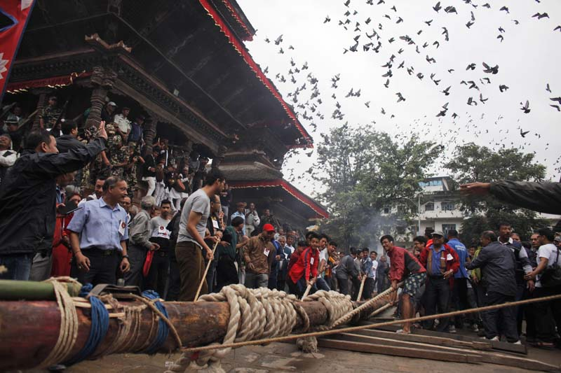 Nepali devotees prepare to erect a wooden pole in front of the ancient royal palace on the beginning of the week-long Indra Jatra festival at Basantapur Durbar Square in Kathmandu, on Tuesday, September 13, 2016. Photo: AP