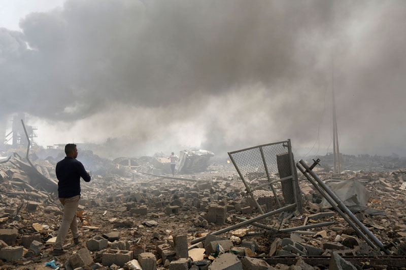 A man walks at a destroyed building at the site of a blast caused by a fire at a weapons storage in eastern Baghdad, Iraq, on September 2, 2016. Photo: Reuters