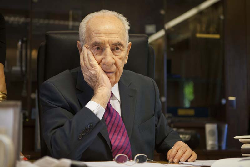 File- Israel's President Shimon Peres listens during an interview with The Associated Press, at his residence in Jerusalem. Shimon Peres, on July 15, 2014. Photo: AP