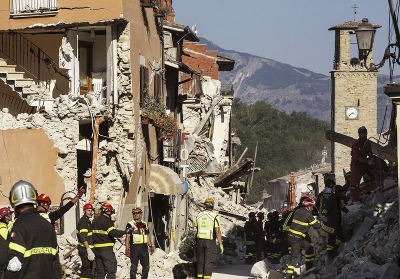 File - Firefighters work in the devastated town of Amatrice, central Italy, three days after a major earthquake on Saturday, Augut 27, 2016. Photo: ANSA via AP