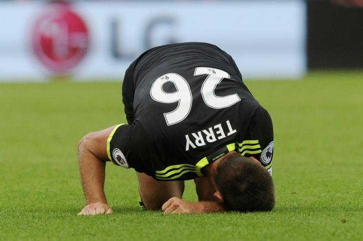 Britain Soccer Football - Swansea City v Chelsea - Premier League - Liberty Stadium - 11/9/16nChelsea's John Terry reacts after sustaining an injurynReuters / Rebecca NadennLivepic