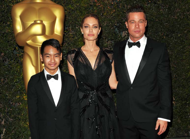 File- Maddox Jolie-Pitt (L) Angelina Jolie (M) and Brad Pitt attend the 2013 Governors Awards in Los Angeles, on November 16, 2013. Photo: AP