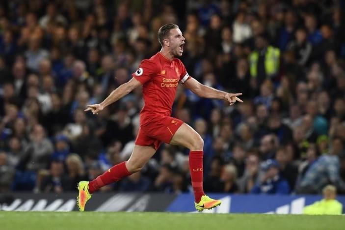 Britain Football Soccer - Chelsea v Liverpool - Premier League - Stamford Bridge - 16/9/16nLiverpool's Jordan Henderson celebrates scoring their second goal nReuters / Dylan Martinez
