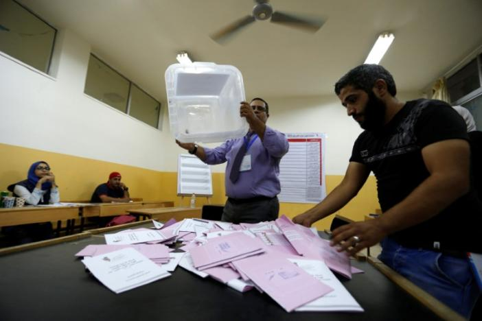 Officials count ballots after polls closed at a polling station for parliamentary elections in Amman, Jordan, September 20, 2016. REUTERS/Muhammad Hamed