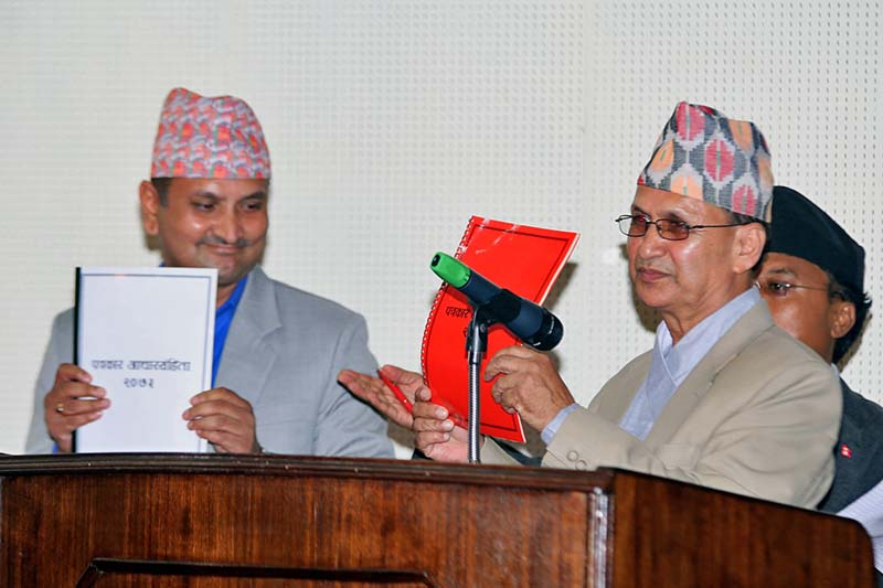 Press Council Nepal Chairman Borna Bahadur Karki  (right) and Federation of Nepali Journalists President Mahendra Bista  make public the 'Journalistic Code of Conduct 2016' amid a function at the President's Office, Sheetal Niwas, on Thursday, September 22, 2016. Photo: RSS