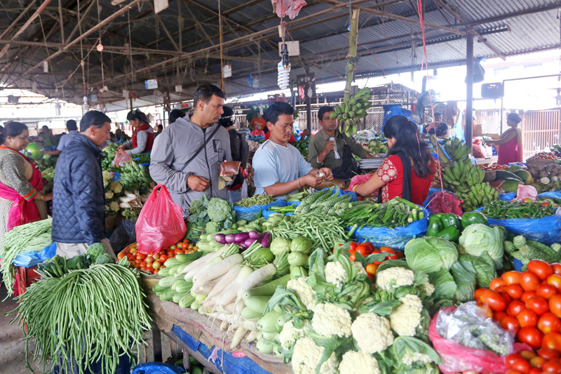 Consumers buying green vegetables at the Kalimati-based vegetable market, on Sunday, September 25, 2016. As the big festivals are approaching closer, consumers are complaining of surge in the vegetable prices. Photo: RSS