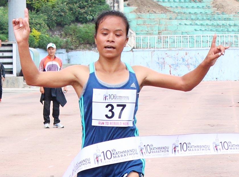 Armed Police Force Club's Kanchhi Maya Koju touches the finishing line of 10th Kathmandu Marathon. Photo: NSJF