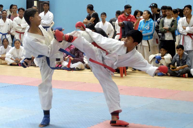 Karate players fight during their 50kg weight category bout of the selection tournament for the South Asian Karate Championship at the International Sports Complex in Lalitpur, on Saturday, September 3, 2016. Photo: Naresh Shrestha/ THT