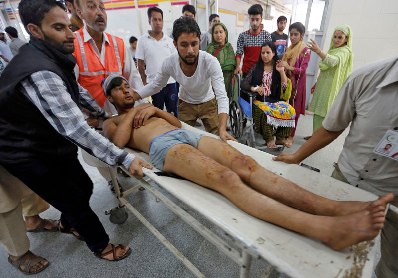 A man is rushed to a hospital in Srinagar for treatment after he was injured in clashes between protesters and Indian police in Karimabad in South Kashmir, on September 11, 2016. Photo: Reuters