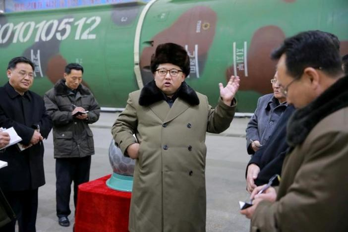 North Korean leader Kim Jong Un meets scientists and technicians in the field of research into nuclear weapons in this undated photo released by North Korea's Korean Central News Agency (KCNA) in Pyongyang March 9, 2016. KCNA/Files via Reuters