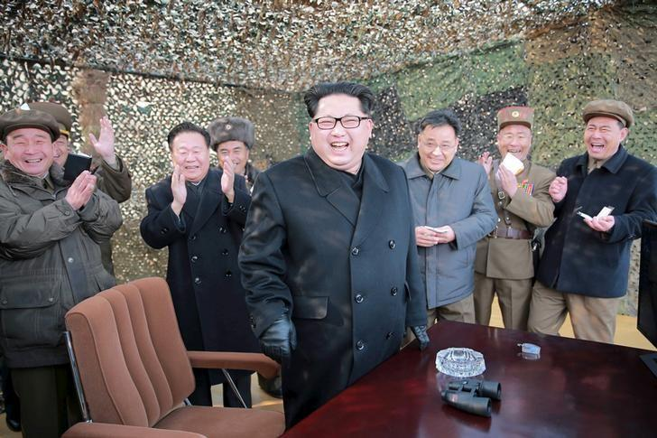 North Korean leader Kim Jong Un (C) smiles as he guides a test fire of a new multiple launch rocket system in this undated photo released by North Korea's Korean Central News Agency (KCNA) in Pyongyang March 4, 2016. REUTERS/KCNA/Files