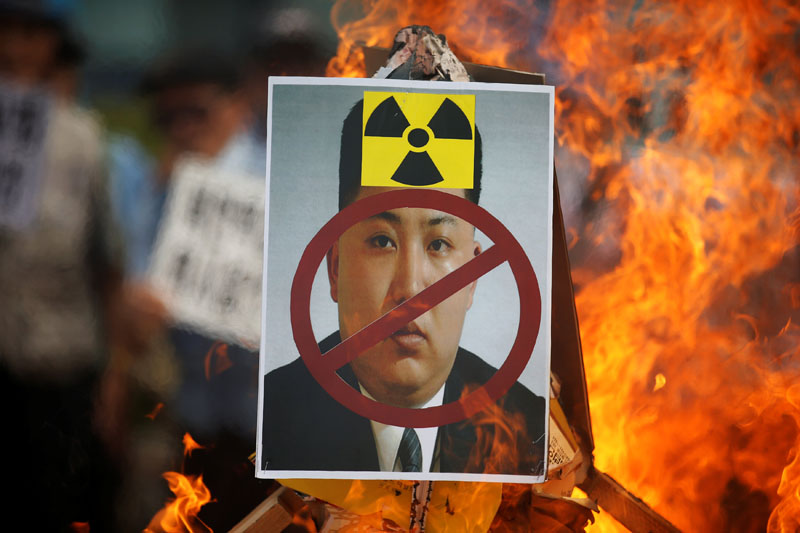 A cut-out of North Korean leader Kim Jong Un is set on fire during an anti-North Korea rally in central Seoul, South Korea, on September 10, 2016. Photo: Reuters