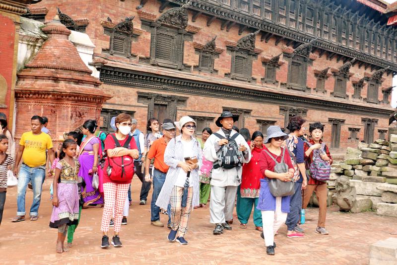 Korean tourists enjoying visiting the Bhaktapur Durbar Square, on Tuesday, September 6, 2016. Photo: RSS
