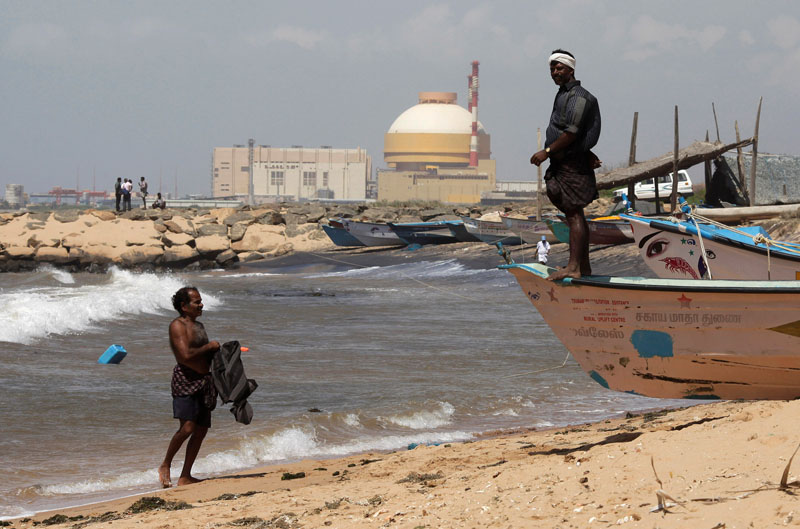 A fisherman stands on his boat on a beach near Kudankulam nuclear power project in the southern Indian state of Tamil Nadu, India, on September 13, 2012. Photo: Reuters