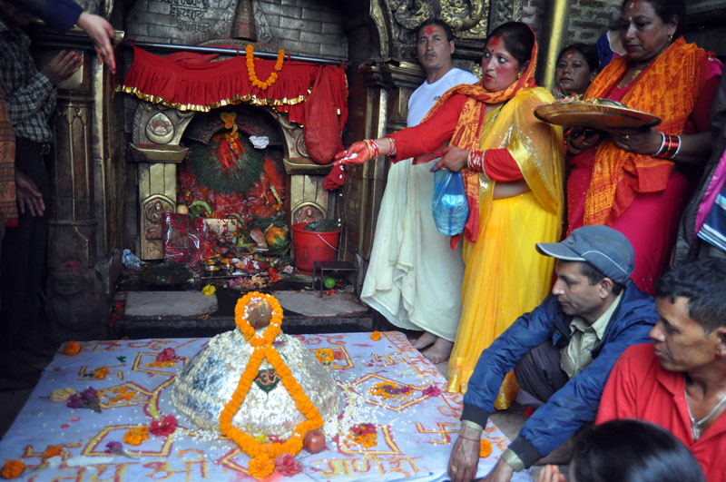 Devotees offer a 55-kilogram laddu (a sweet dish) as they celebrate the Ganesh Chaturthi festival at the Surya Binayak Temple in Bhaktapur on Monday, September 05, 2016. Photo: RSS