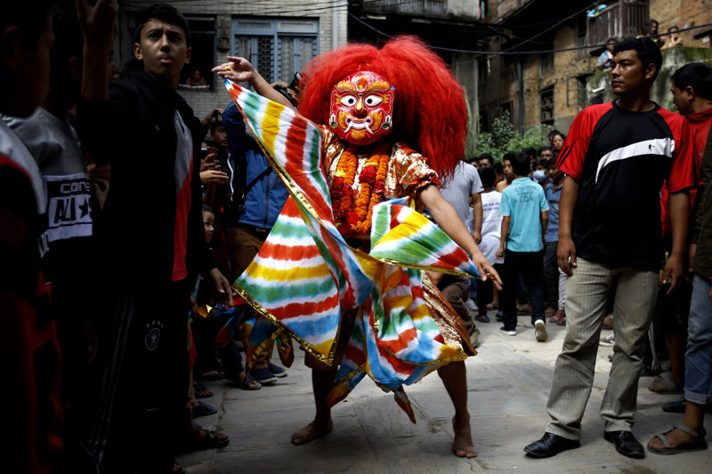 A person performs a Lakhey dance after erecting the Indradhoj Linga, a ceremonial pole commencing the first day of the eight-day long Indrajatra festival, celebrated to honor Indra, the King of Heaven and Lord of Rains in Hanumandhoka Durbar Square in Kathmandu on Tuesday, September 13, 2016. Indrajatra is the biggest religious street festival held annually in Nepal.  Singing, mask dance, rejoicing and devotees offering prayers along with other rituals hold the eight-day festival celebrated by both Hindus and Buddhists. Photo/Skanda Gautam