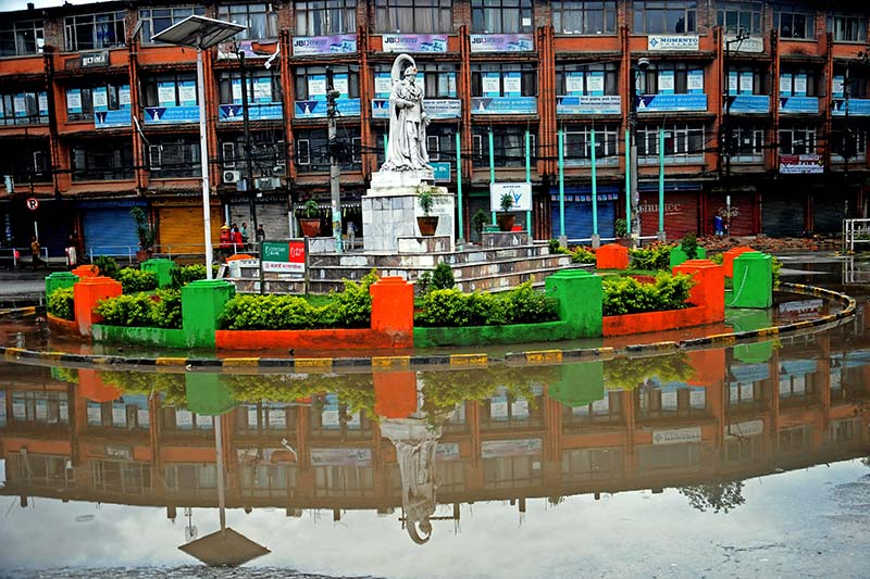 A reflection of late king Tribhuvan Shah's statue seen after heavy rainfall at the waterlogged crossing in Tripureshwor, Kathmandu, on Saturday, September 24, 2016. Photo: Bal Krishna Thapa/ THT