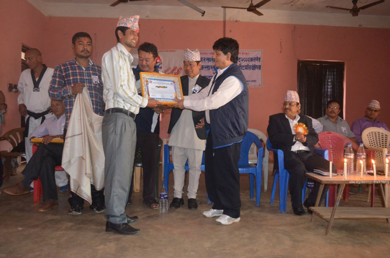 THT journalist Laxmi Gautam (left) nbeing felicitated by Panchthar nDistrict Sports Development nCommittee in Phidim on Friday.