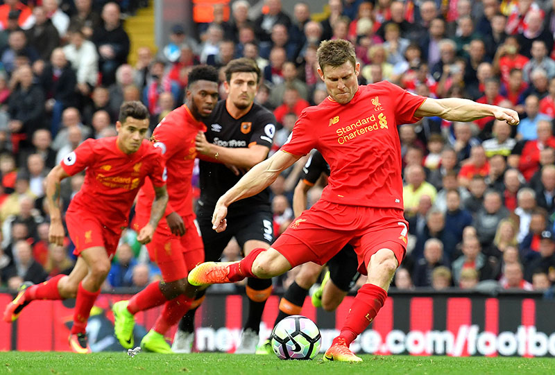 Liverpool's James Milner scores his team's fifth goal of the game from the penalty spot during the English Premier League football match between Liverpool and Hull City at Anfield Stadium in Liverpool, England, on Saturday, September 24, 2016.Photo: Dave Howarth/PA via AP
