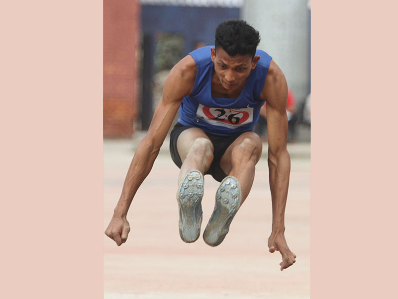 Bhuwan Mahato of Central Region jumps during boyu2019s long jump final of the first Youth and Junior nNational Athletics Championship at the Dasharath Stadium in Kathmandu on Tuesday, September 20, 2016. Photo: Udipt Singh Chhetry/THT