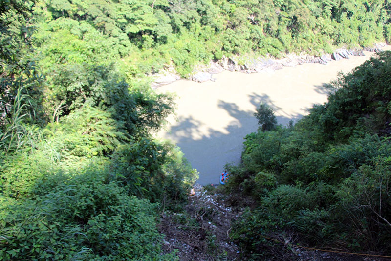 A view of the Trishuli River from a point of the Prithvi Highway from where a jeep carrying former minister Madhav Ghimire plunged into the Trishuli River, killing at least three, in Chitwan district, on Sunday, September 25, 2016. Photo: RSS