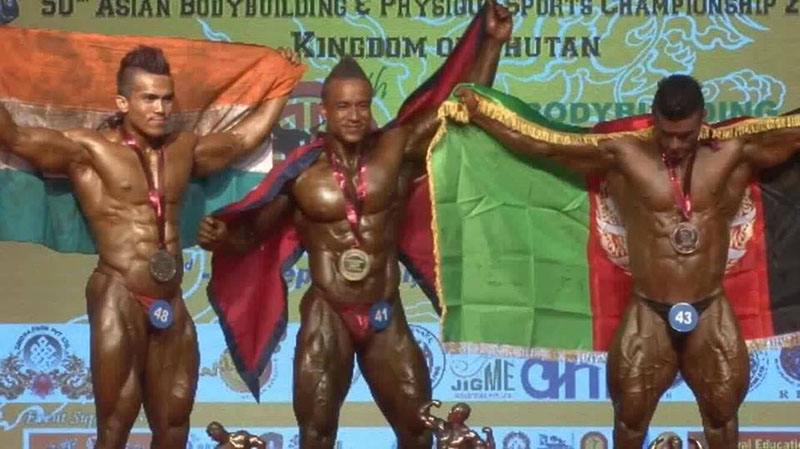 Nepalu2019s Maheshwor Maharjan (centre) celebrates on the podium after winning gold medal in the 50th Asian Body Building Championship in Thimpu on Tuesday, September 6, 2016.