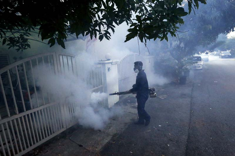 File- A worker of Ministry of Health Malaysia carries out mosquito fogging at Kuala Lumpur, Malaysia, on September 14, 2016. Photo: AP