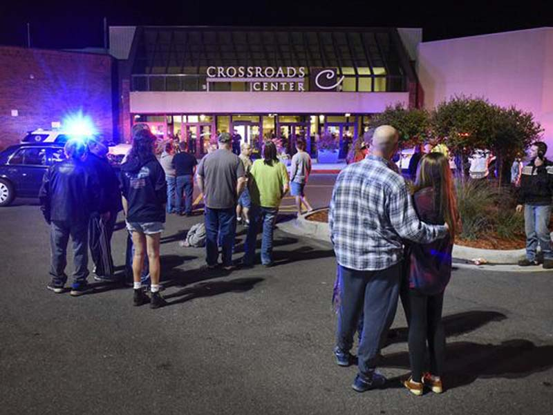 People stand near the entrance on the north side of Crossroads Center mall between Macy's and Target as officials investigate a reported multiple stabbing incident, in Saint Cloud, Minnesota  on Saturday, September 17, 2016. Photo: AP