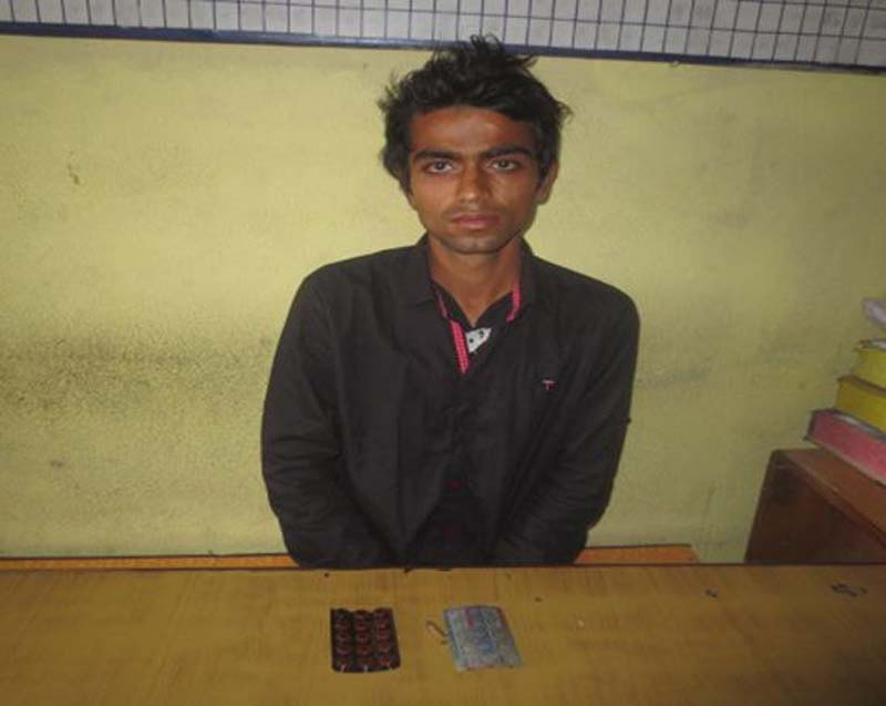 Police parade a man arrested in possession of a bullet and other contraband, in Baneshwor of Kathmandu, on Sunday, September 25, 2016. Photo: Metropolitan Police Office