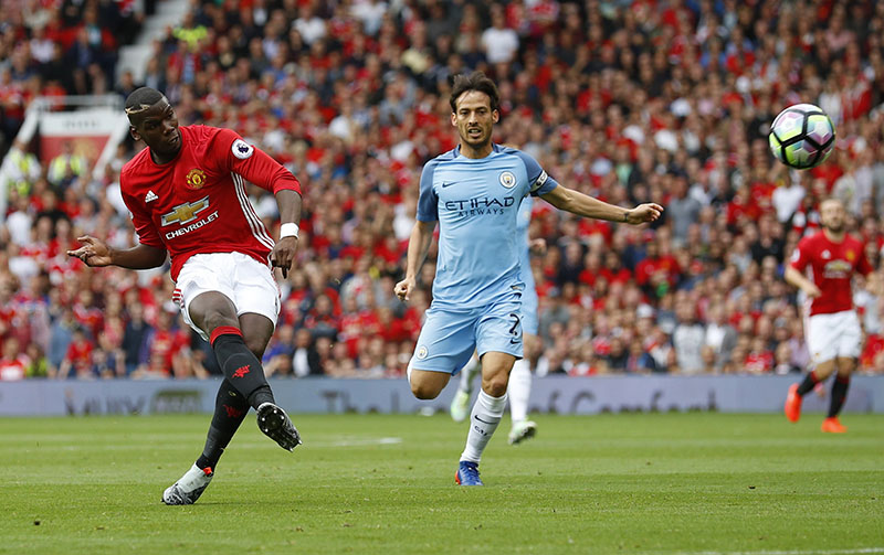Manchester United's Paul Pogba  (left) shoots the ball during the English Premier League football match against Manchester City, at Old Trafford, on Saturday, September 10, 2016. Photo: Reuters