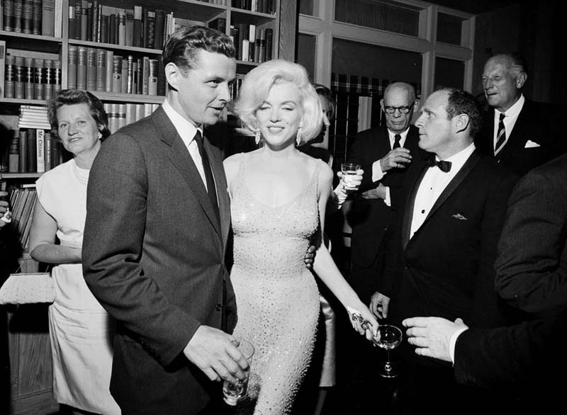 In this May 19, 1962 photo provided by the John F. Kennedy Presidential Library and Museum, actress Marilyn Monroe wears the iconic gown that she wore while singing u0093Happy Birthdayu0094 to President John F. Kennedy at Madison Square Garden, during a reception in New York City. Standing next to Monroe is Steve Smith, President John F. Kennedyu0092s brother-in-law. Julien's Auctions will offer Monroeu0092s gown at auction in Los Angeles on Nov. 17, 2016. The sultry actress wore the barely-there dress at Kennedy's 45th birthday celebration. (Cecil Stoughton/White House Photographs, John F. Kennedy Presidential Library and Museum via AP)