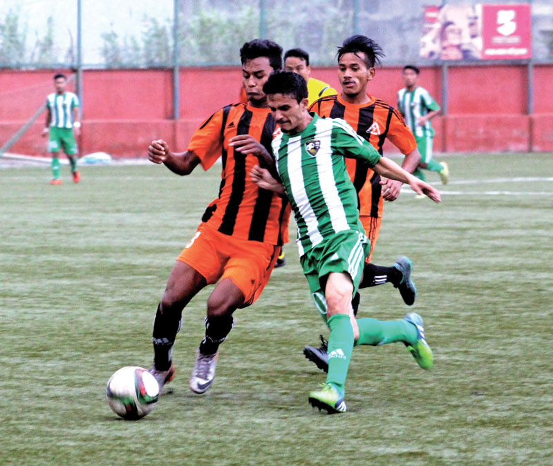 Players of NRT and Mahabir Club (left) vie for the ball during their Martyrs Memorial B Division League match at the ANFA Complex grounds in Lalitpur on Sunday.