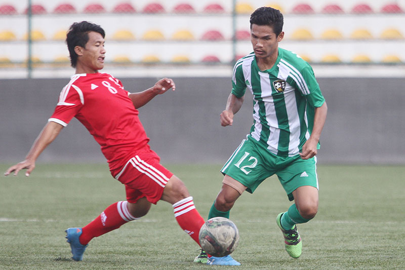 Players of RCT and NRT (right) vie for the ball during their Martyrs Memorial B Division League match at the ANFA Complex grounds in Lalitpur on Thursday, September 22 2016. Photo: Udipt Singh Chhetry/THT