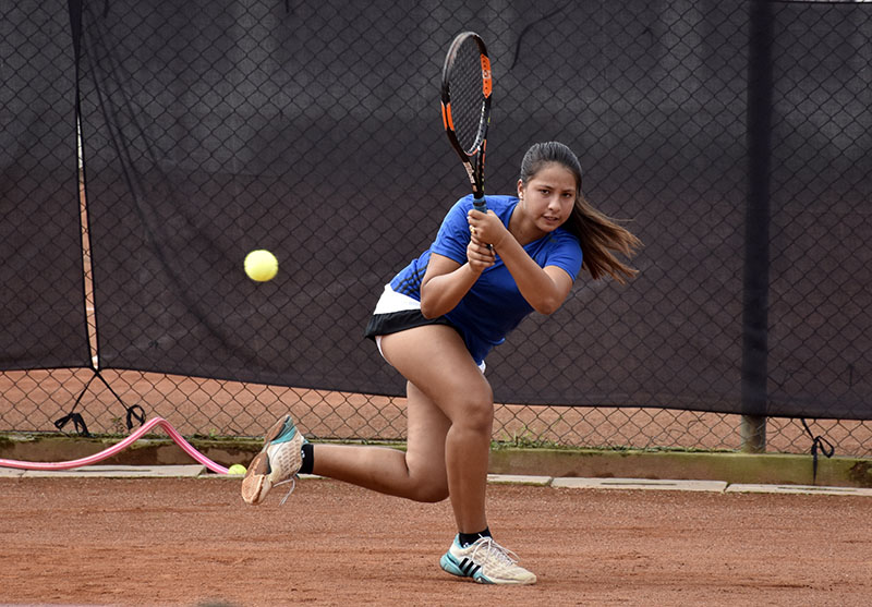 Mayanka Rana returns to her sister Mahika during their womenu2019s singles semi-final match of the first National Open Lawn Tennis Tournament at the Tennis Complex in Lalitpur on Monday, September 26, 2016. Mayanka won the match 6-0, 1-6, 6-0. Photo: Naresh Krishna Shrestha/THT