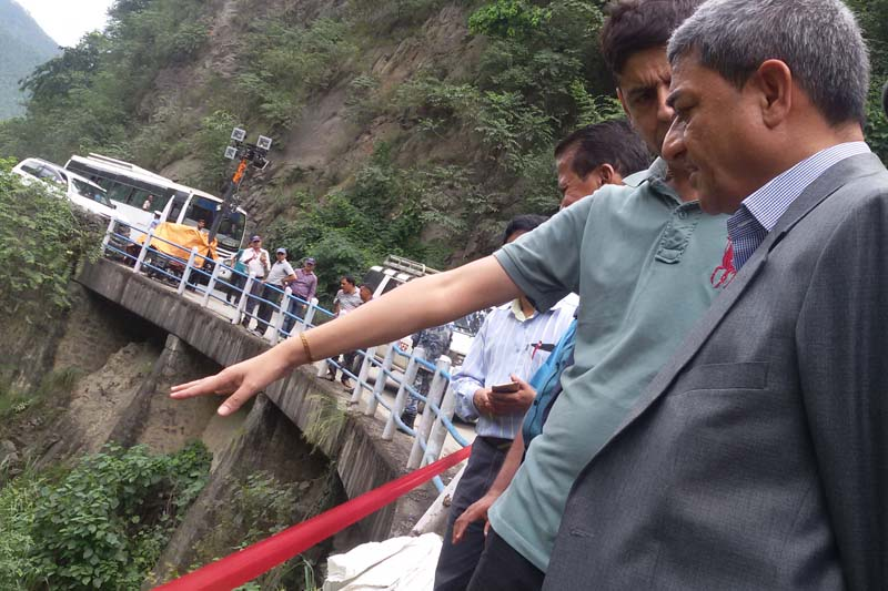 Minister for Physical Infrastructure and Transport Ramesh Lekhak reaches Ghoptebhir to inspect an incident site from where former minister Madhav Ghimire's vehicle plunged into the Trishuli River, along the Prithvi Highway, in Darechok-3 in Chitwan district on Monday, September 26, 2016. Ghimire along with his two younger brothers is missing since the incident. Photo: Tilak Ram Rimal/ THT