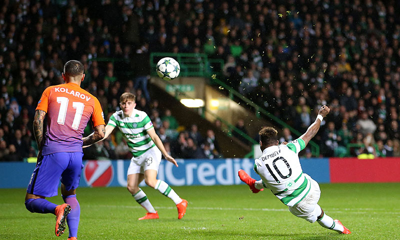 Celtic's Moussa Dembele (right) scores his side's third goal of the game during the Champions League, Group C soccer match, Celtic versus Manchester City, at Celtic Park, Glasgow, Scotland, on Wednesday September 28, 2016. Photo: Jane Barlow/PA via AP
