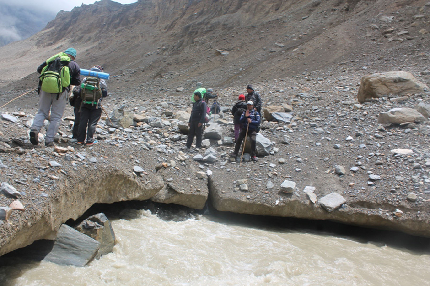 Trekkers destined for Mount Dhaulagiri Base Camp cross the glacial Myagdi Khola in Mudi VDC of Myagdi district, on Friday, September 30, 2016. Photo: RSS