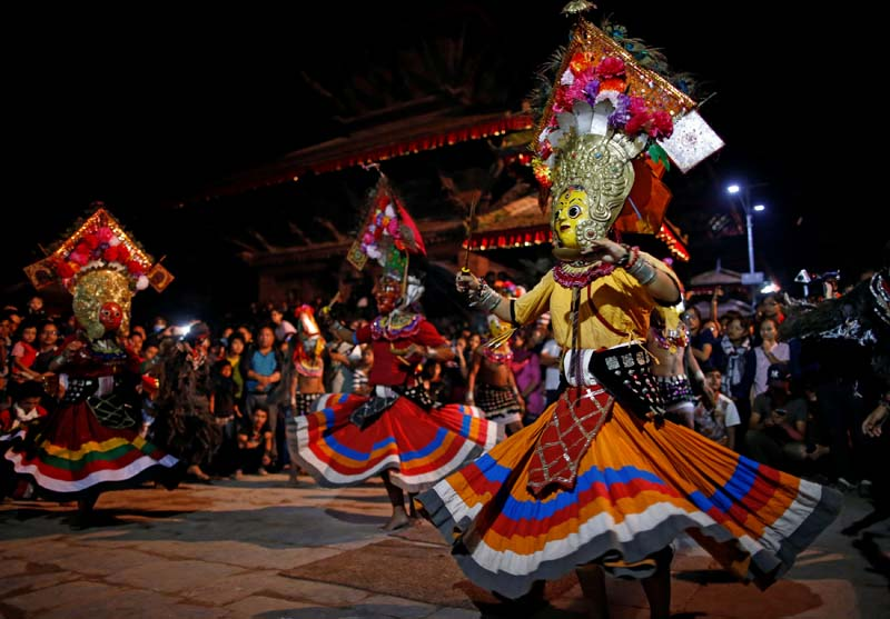 Masked dancers perform a traditional mask dance during the Indra Jatra festival in Kathmandu, on Tuesday, September 13, 2016. Photo: Reuters
