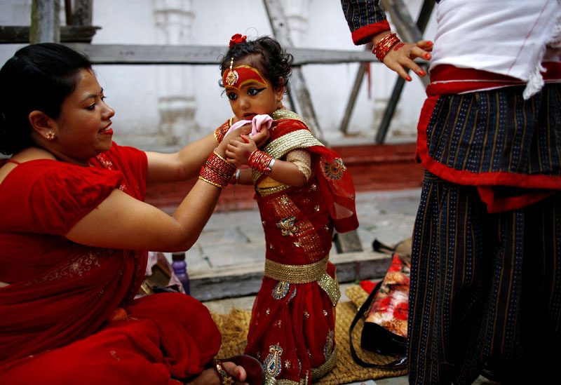 A young girl dressed as the Living Goddess Kumari takes part in the Kumari Puja festival in Kathmandu, on Wednesday, September 14, 2016. Photo: Reuters
