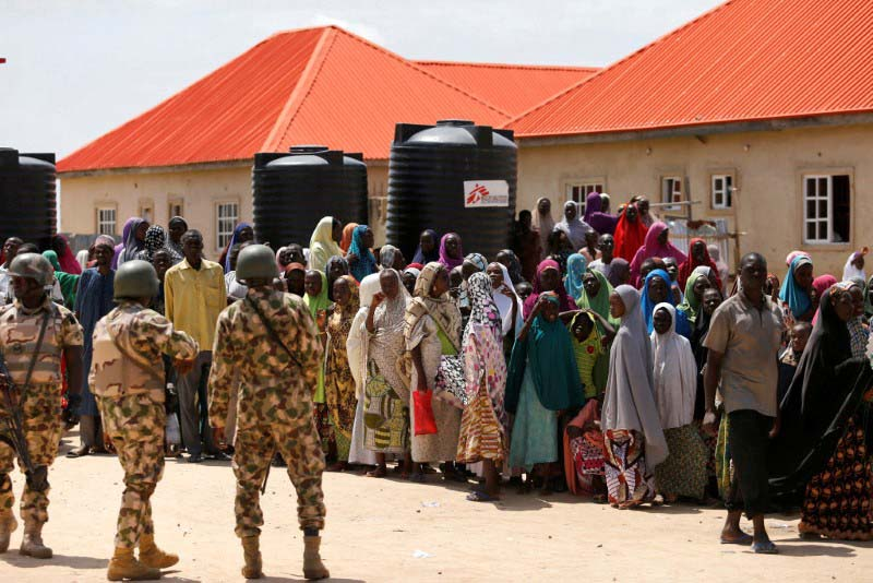 File- Security officers are seen at the Bakkasi camp for internally displaced people, after security was called to control some refugees, who rallied against camp authorities for what they say is poor distribution of food rations, in Borno, Nigeria, August 29, 2016. Photo: Reuters